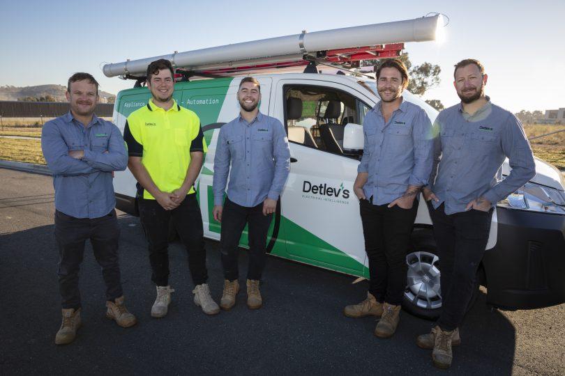 The Detlev's team standing in front of their van