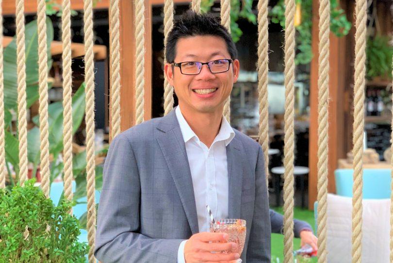 Alan Tse holding Altina Drinks beverage