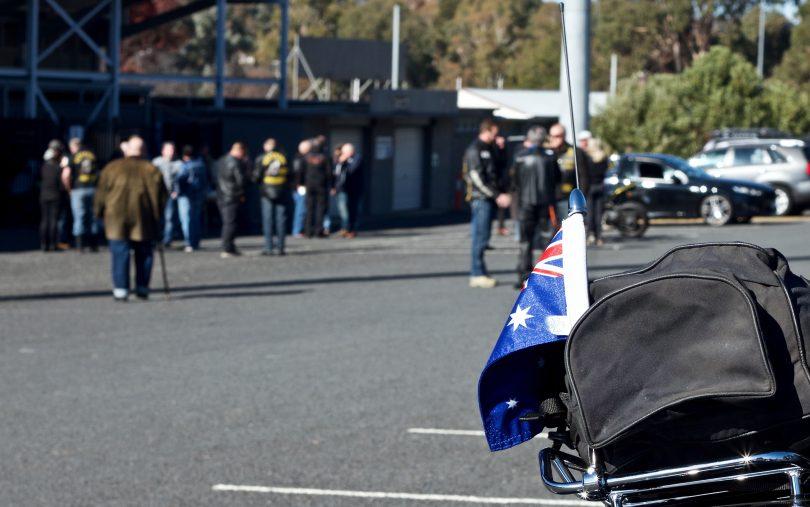 Veterans Motorcycle Club members with motorbike in foreground