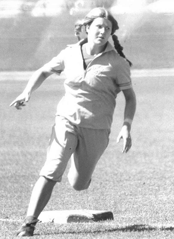 Robin Duff playing softball in 1970s