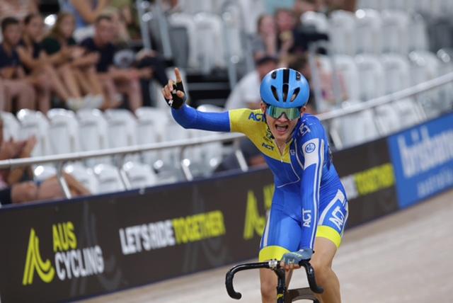 Cameron Rogers racing on bike