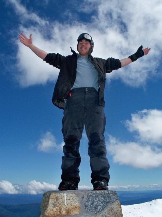 Andrew Drake on top of Mount Kosciusko