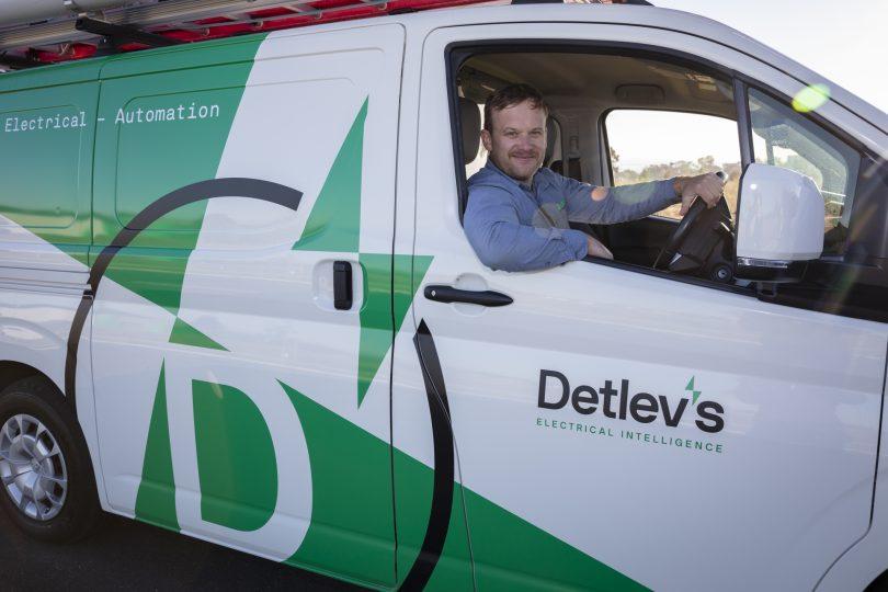 Grae Munroe sitting in Detlev's electrical services van