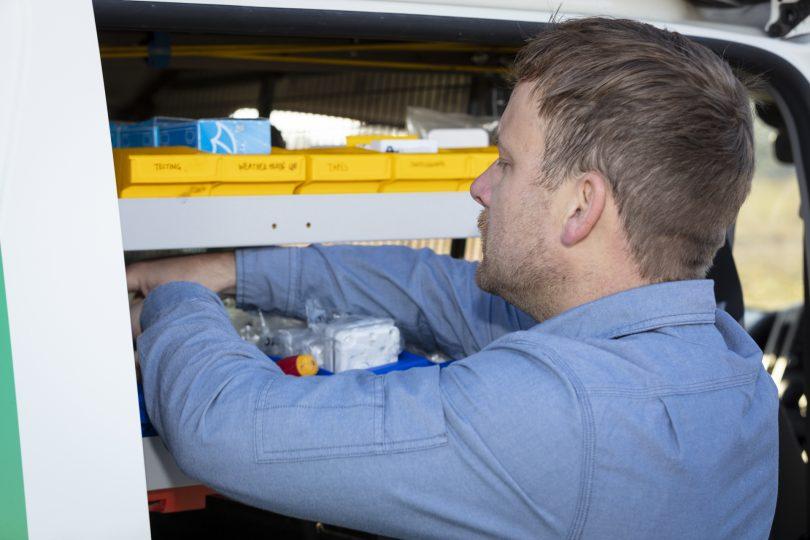 Grae Munroe finds parts on shelf in Detlev's electrical service van