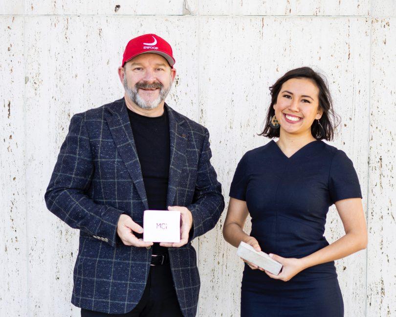 Marcus Dawe and Sophia Hamblin Wang holding MCi product