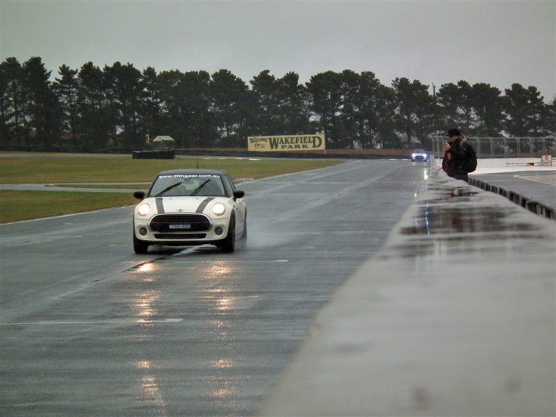 Car on wet race track