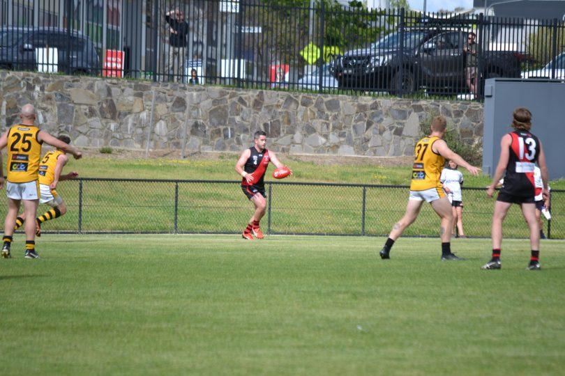 Aaron Bruce playing Australian rules football for Eastlake Demons