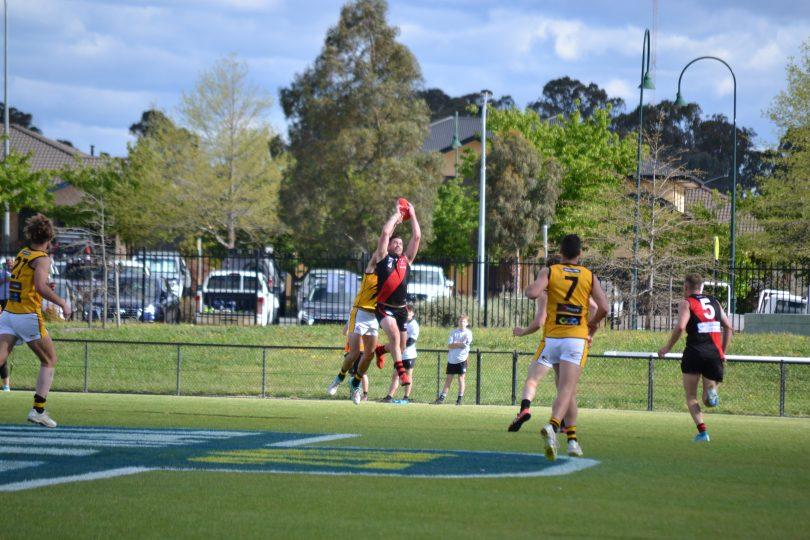 Aaron Bruce marking ball in Australian rules football game