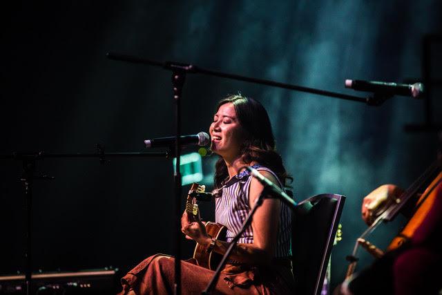 Musician Kim Yang performing onstage