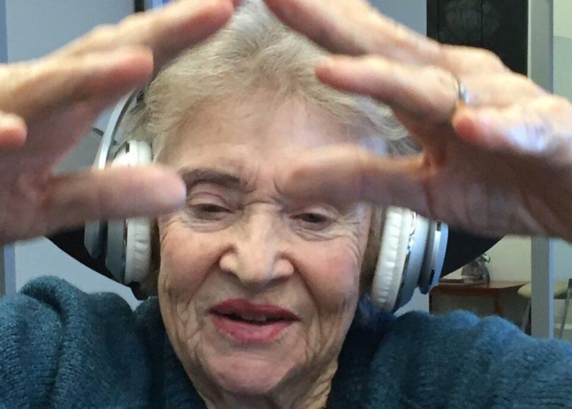 Maureen Du Toit listening to music through headphones