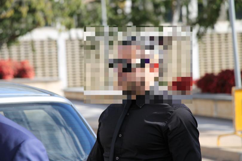 Man entering court