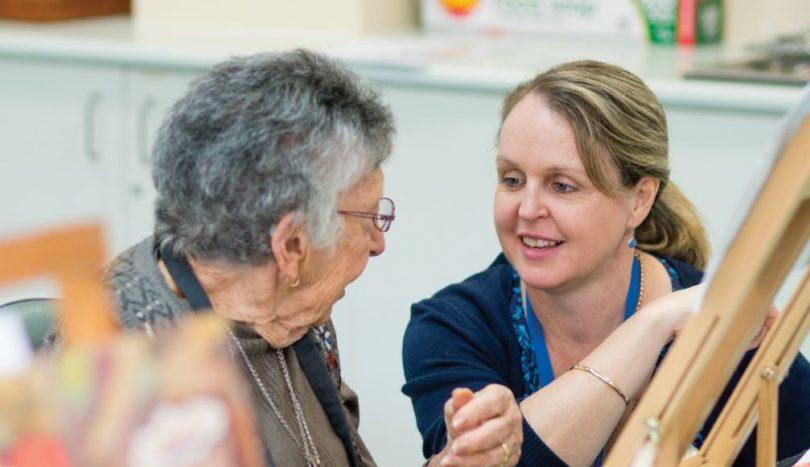 Palliative care volunteer with elderly lady