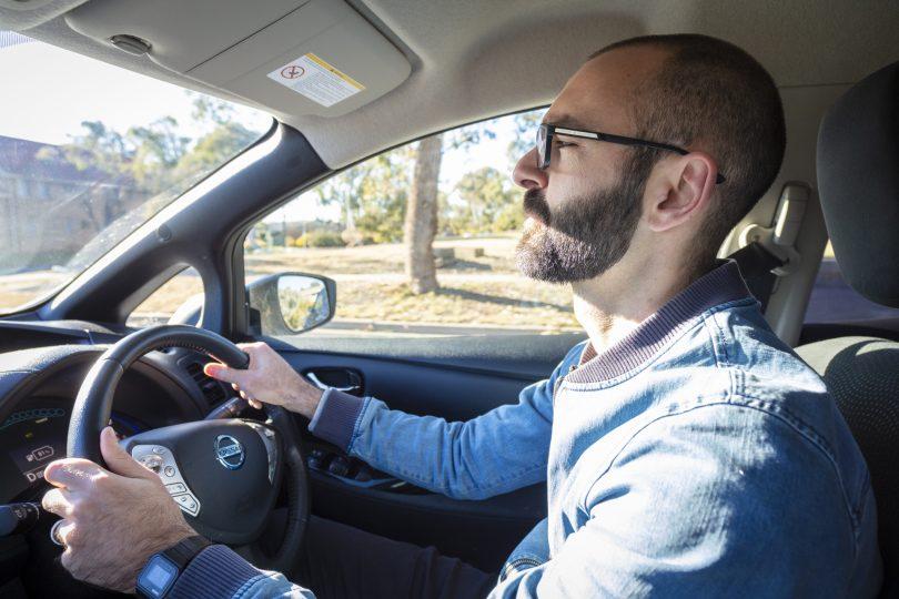 David Haynes driving Nissan Leaf electric vehicle