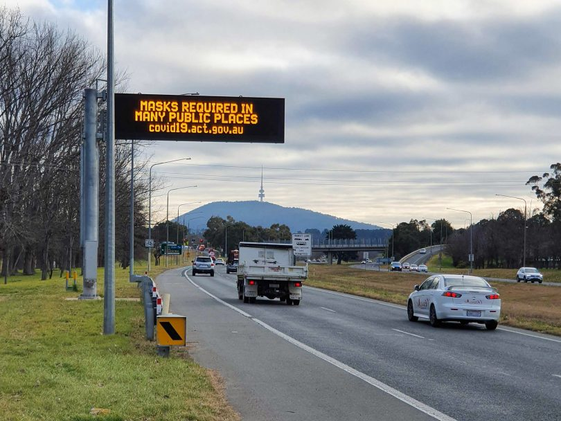 Sign warning Canberrans about new mask requirements