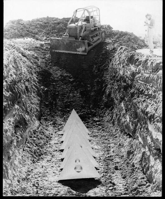 Bert Flugelman's sculpture being buried