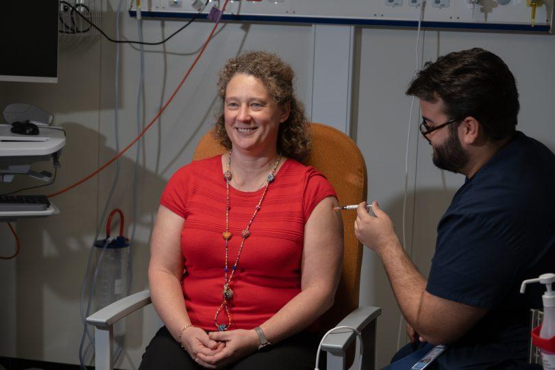 Dr Kerryn Coleman receiving a vaccine