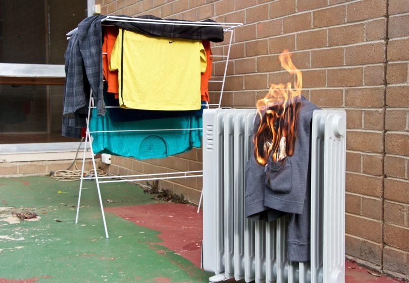 Burning garment on outdoor heater