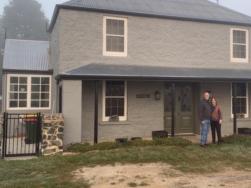 John and Rose Bell standing outside 'Rosythe' property in Breadalbane