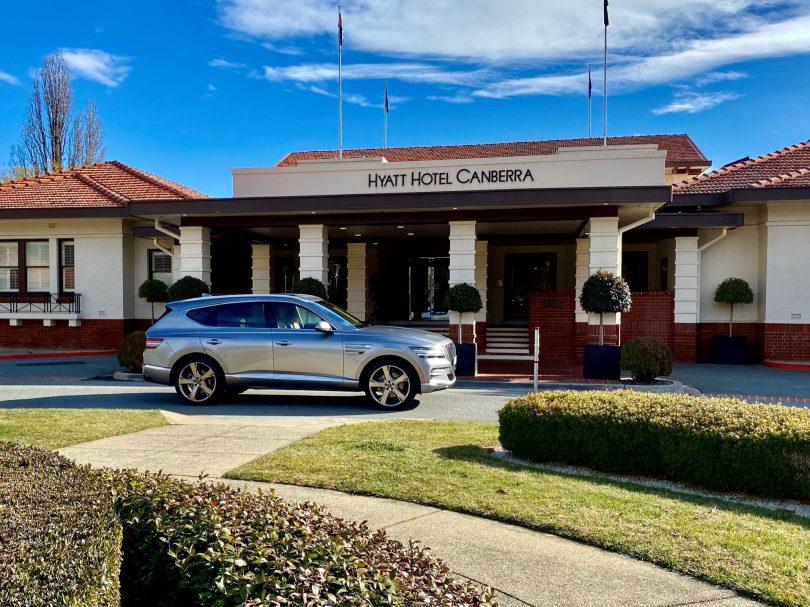 Genesis GV80 at front of Hyatt Hotel Canberra