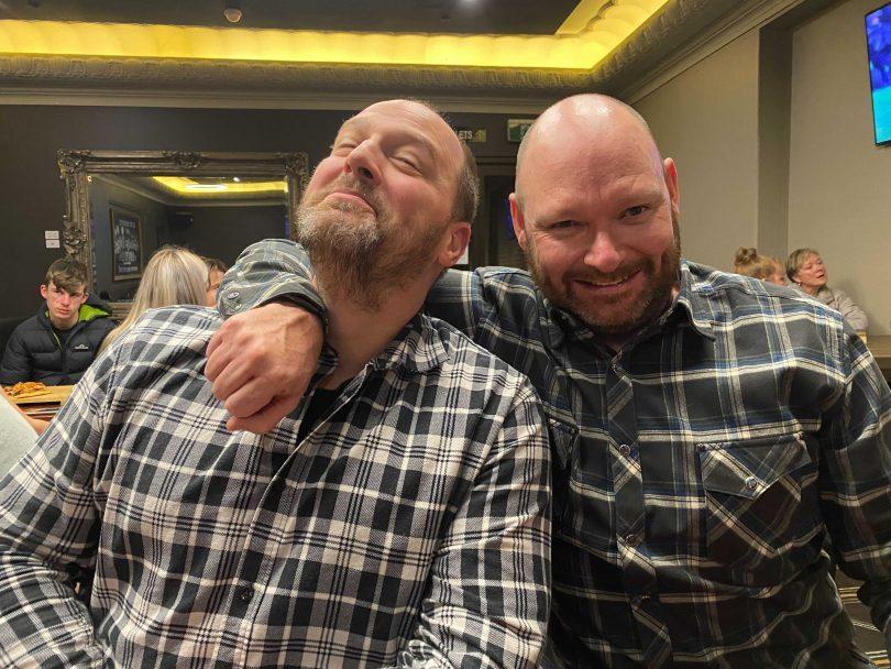 Two men in flanelette shirts