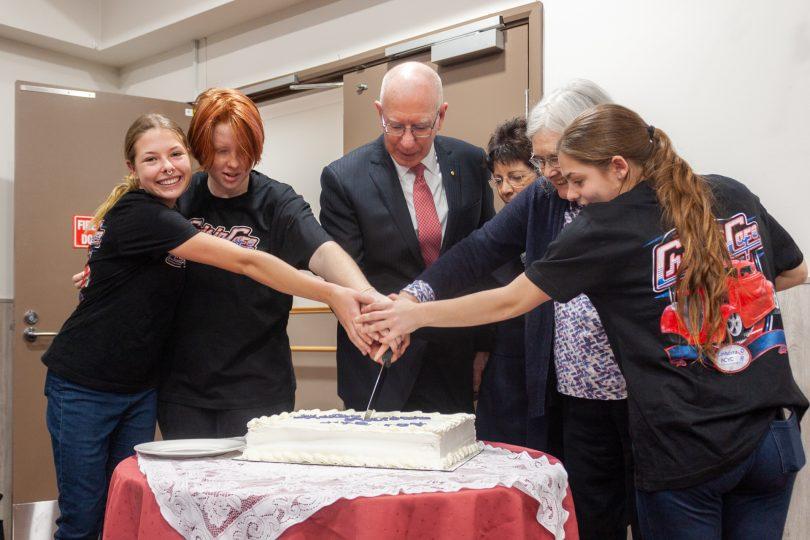 people cutting cake