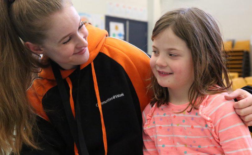 Communities@Work staff and child