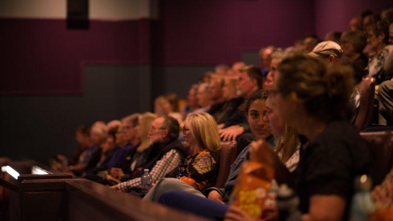 Audience watching movie in cinema