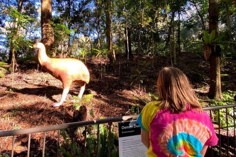 Demon duck of doom statue in trees at Australian National Botanic Gardens