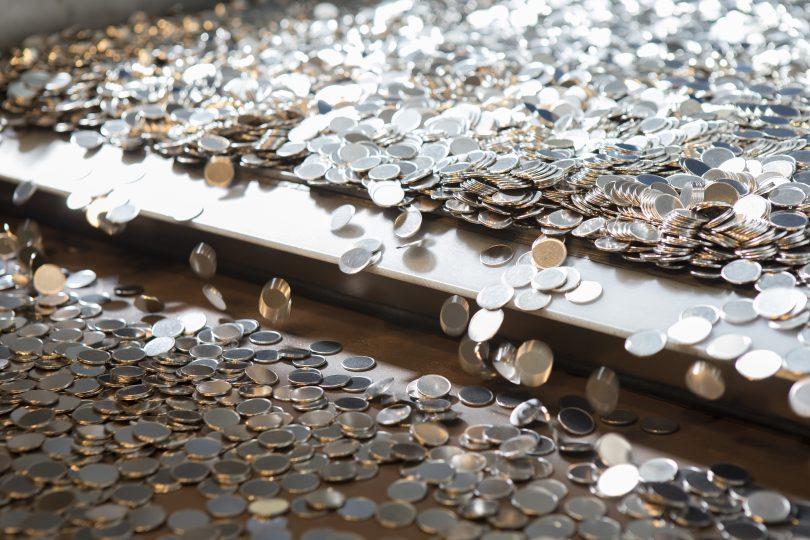 Blank coins fall from conveyor belt at Royal Australian Mint