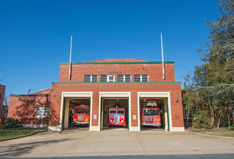 Forrest Fire Station and three red trucks