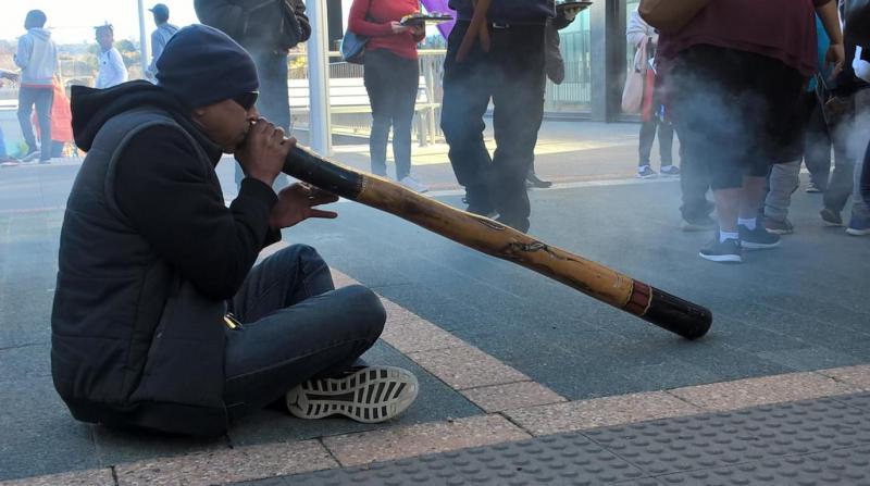 man playing didgeridoo