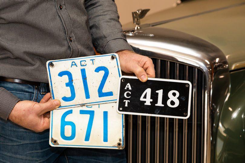 Darrell Leemhuis holding three ACT three-digit number plates