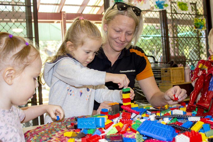 Communities@Work educator with children