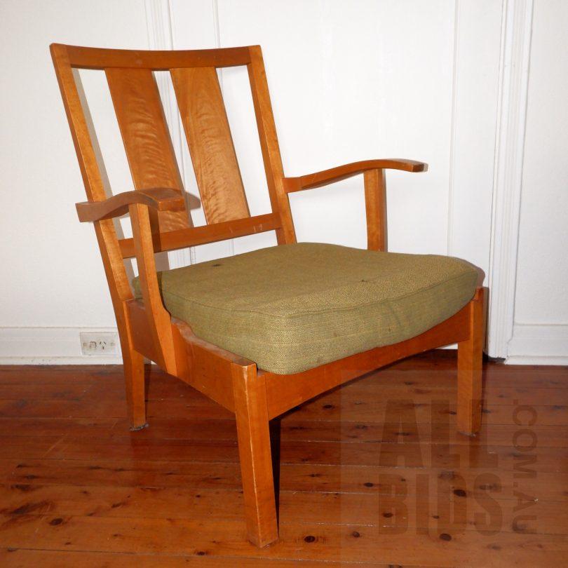 Wooden chair on wooden floor.