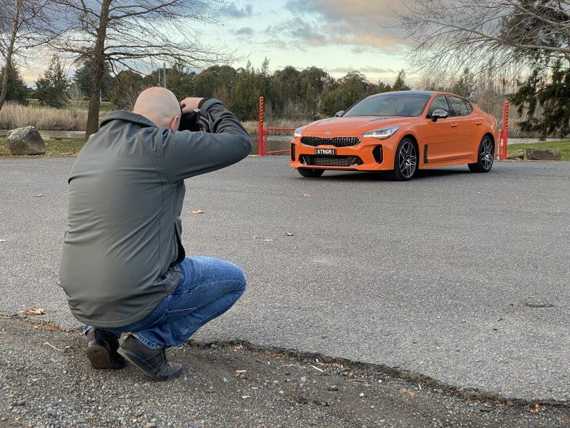 Michael Briguglio taking photo of car