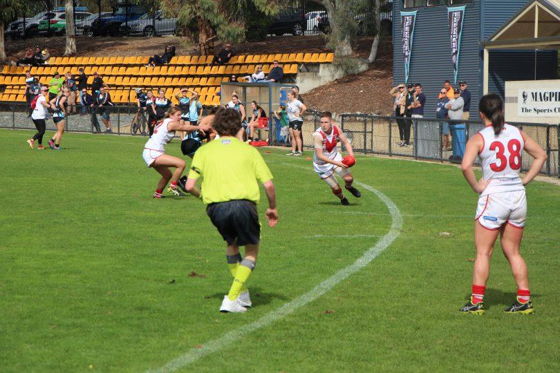 Karina Demant playing Australian rules football for Eastlake Demons