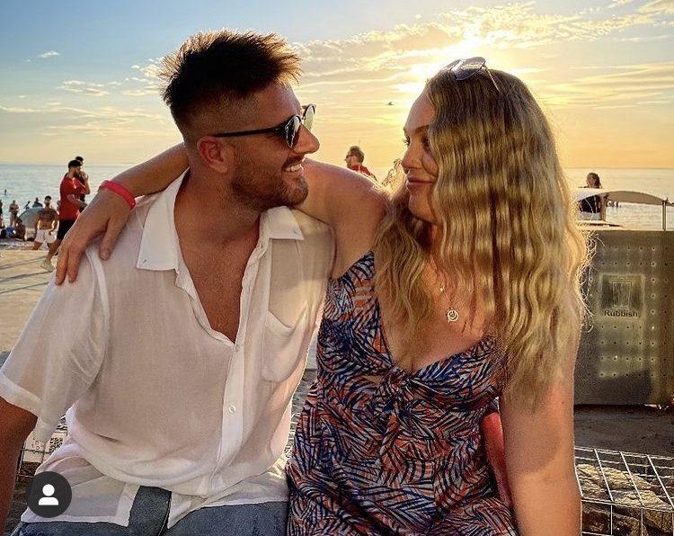 Bryce Ruthven and Melissa Rawson embracing at beach