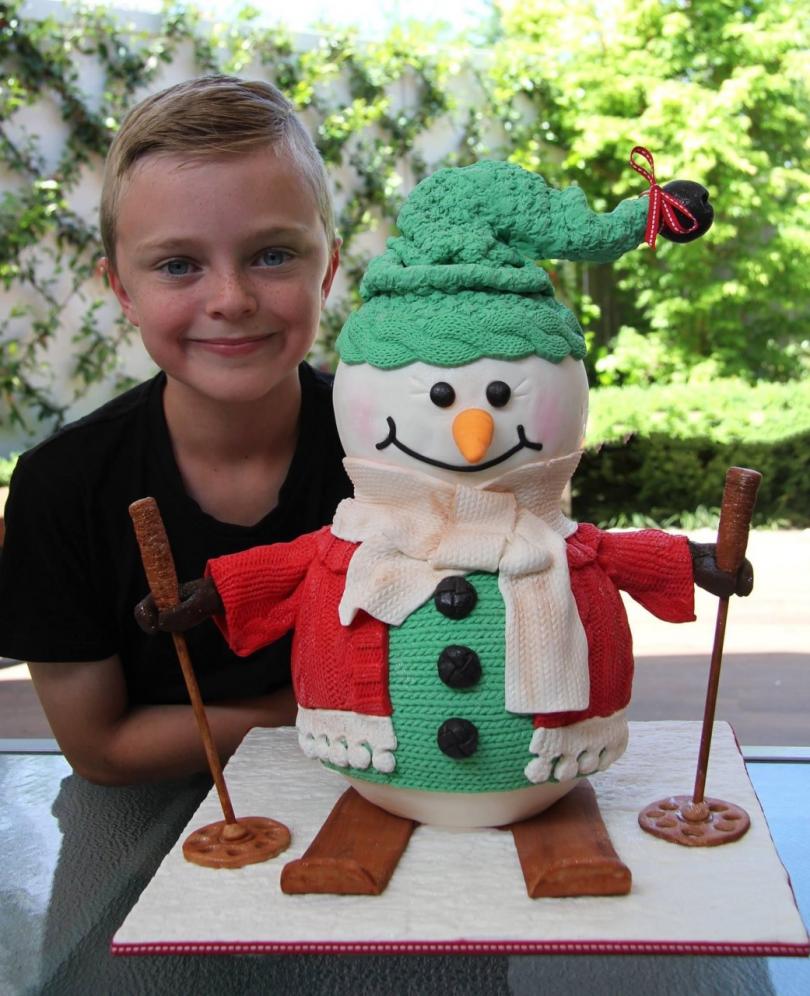 Ethan Penton with his award-winning decorated cake