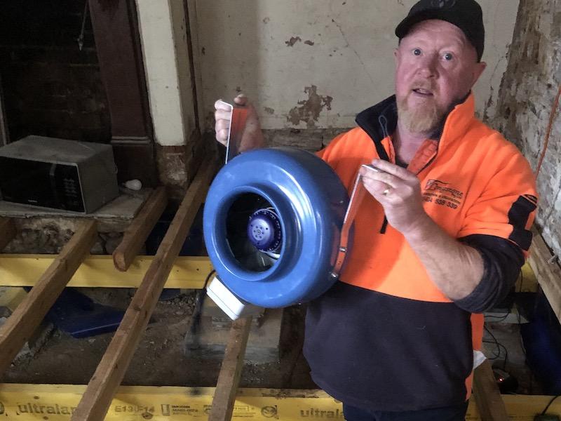 Owen Carragher holding fan at St Clair in Goulburn