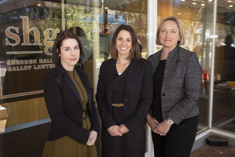 Amber Wang, Emily Shoemark and Julia Bridgewater standing outside Sneddon Hall and Gallop Lawyers office