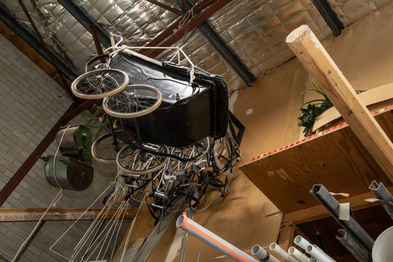 Pram hanging from roof