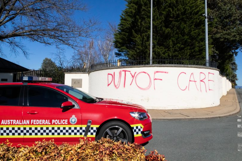 'Duty of Care' graffiti at entrance to The Lodge.