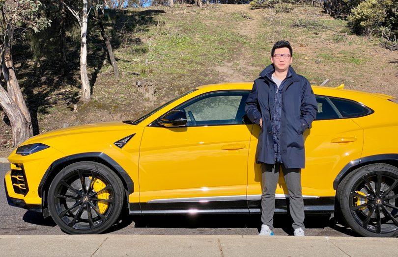 Jack Wang standing in front of yellow Lamborghini Urus