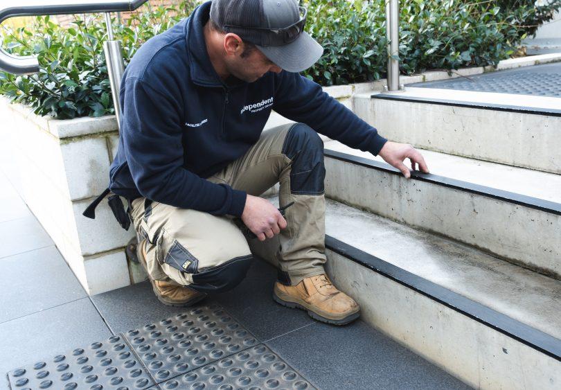 Gavin Dunley doing a maintenance check