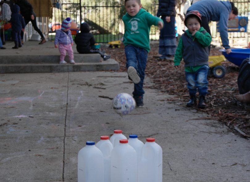 Child kicks ball into milk cartoons