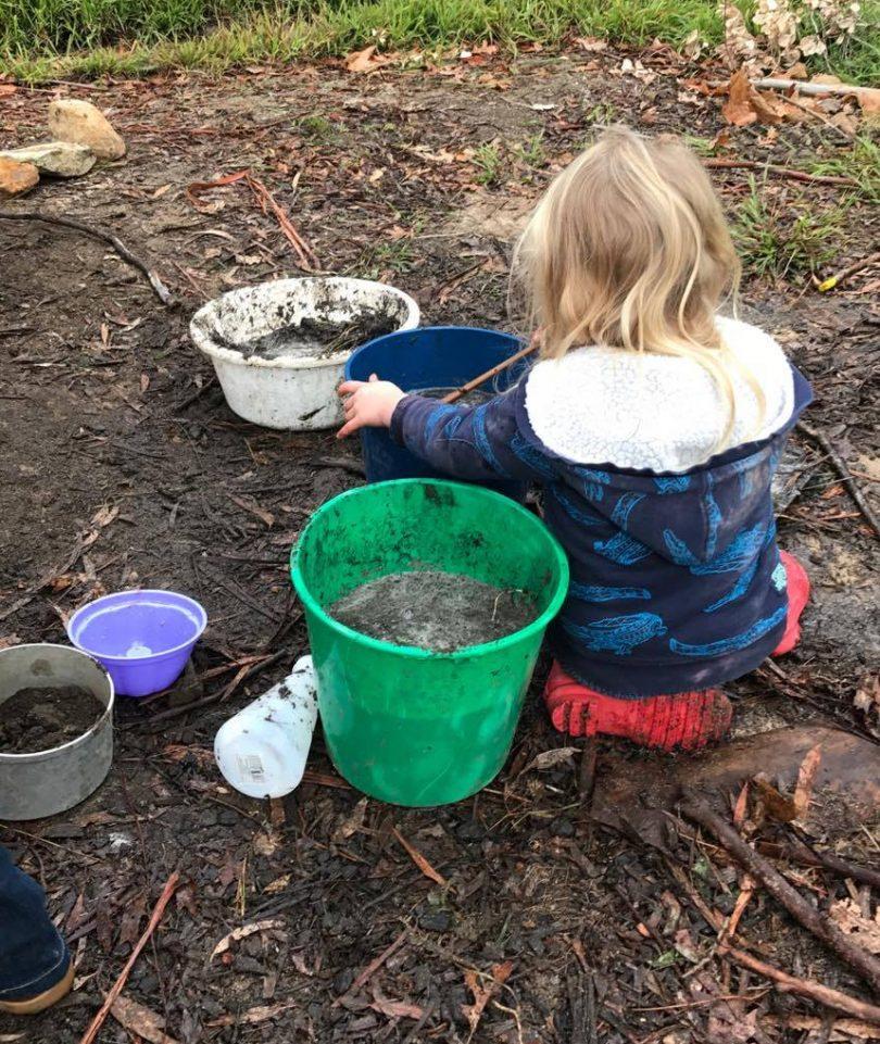 Child plays in mud