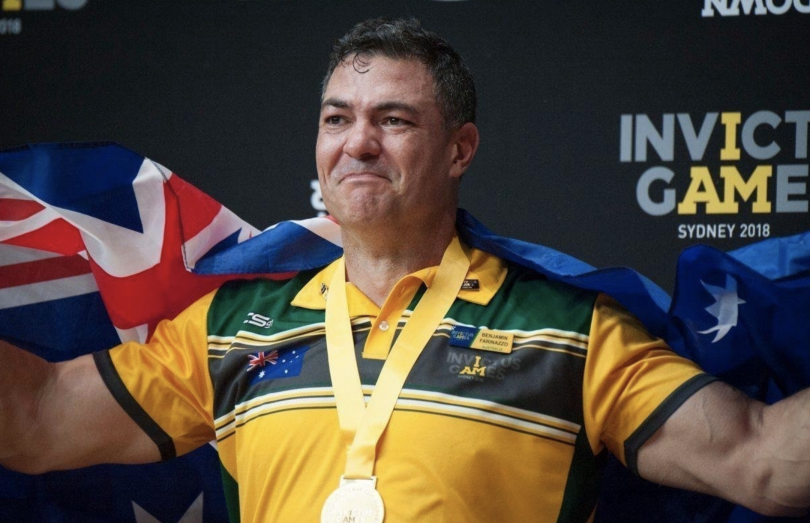 Ben Farinazzo with gold medal and Australian flag at Invictus Games