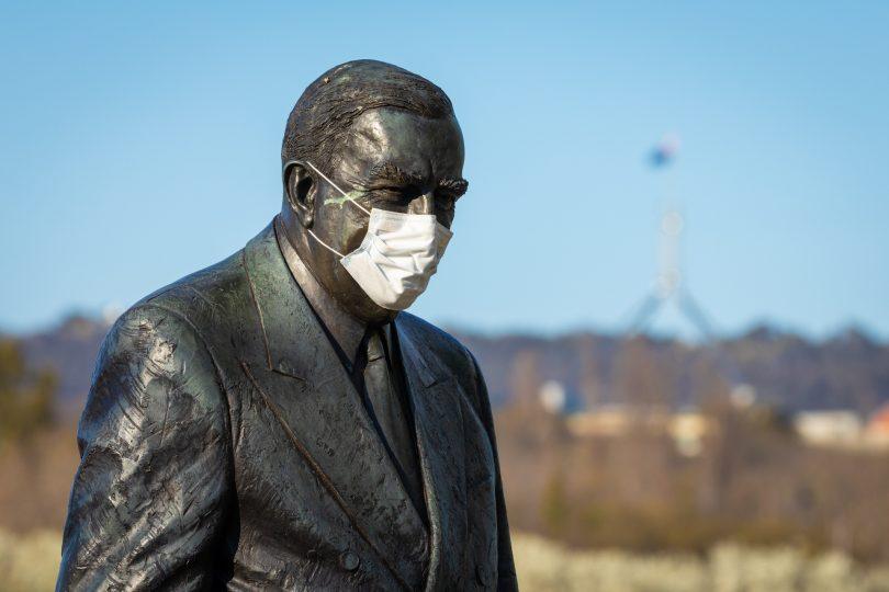Sir Robert Menzies statue wearing a mask