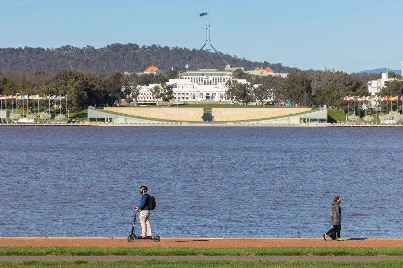Man riding e-scooter at Lake Burley Griffin