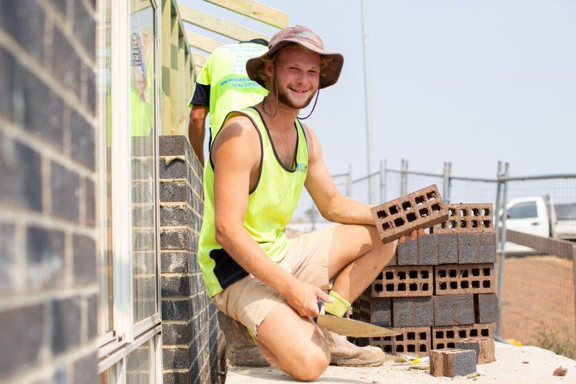 Callum Furner laying bricks on building site